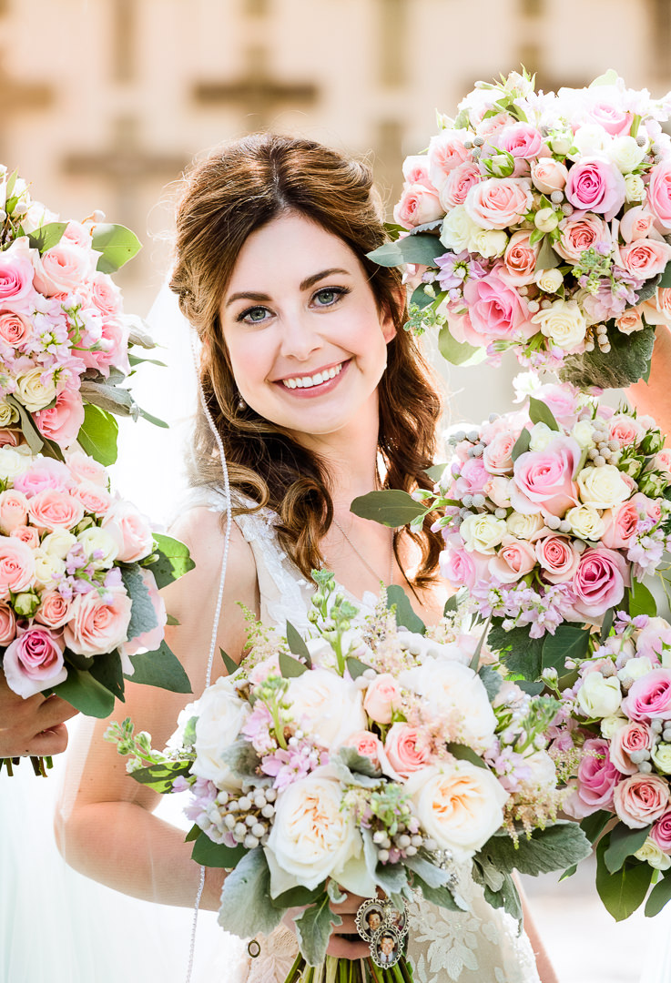 Bride surrounded by flowers outside the Destin Bay House Wedding, Destin Florida, Lazzat Photography, Florida wedding photographer, Orlando wedding photographer