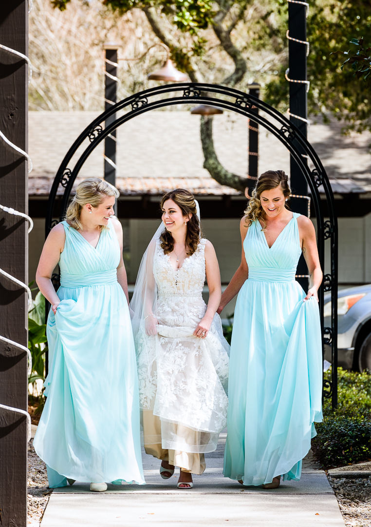 Bride walking with her Bridesmaids outside the Destin Bay House Wedding, blue Bridesmaid dresses, Destin Florida, Lazzat Photography, Florida wedding photographer, Orlando wedding photographer