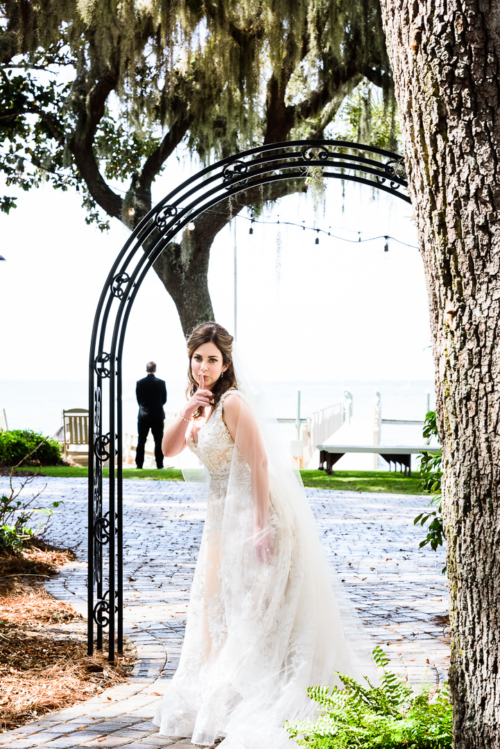 Bride saying shh before the first look outside the Destin Bay House Wedding, Destin Florida, Lazzat Photography, Florida wedding photographer, Orlando wedding photographer