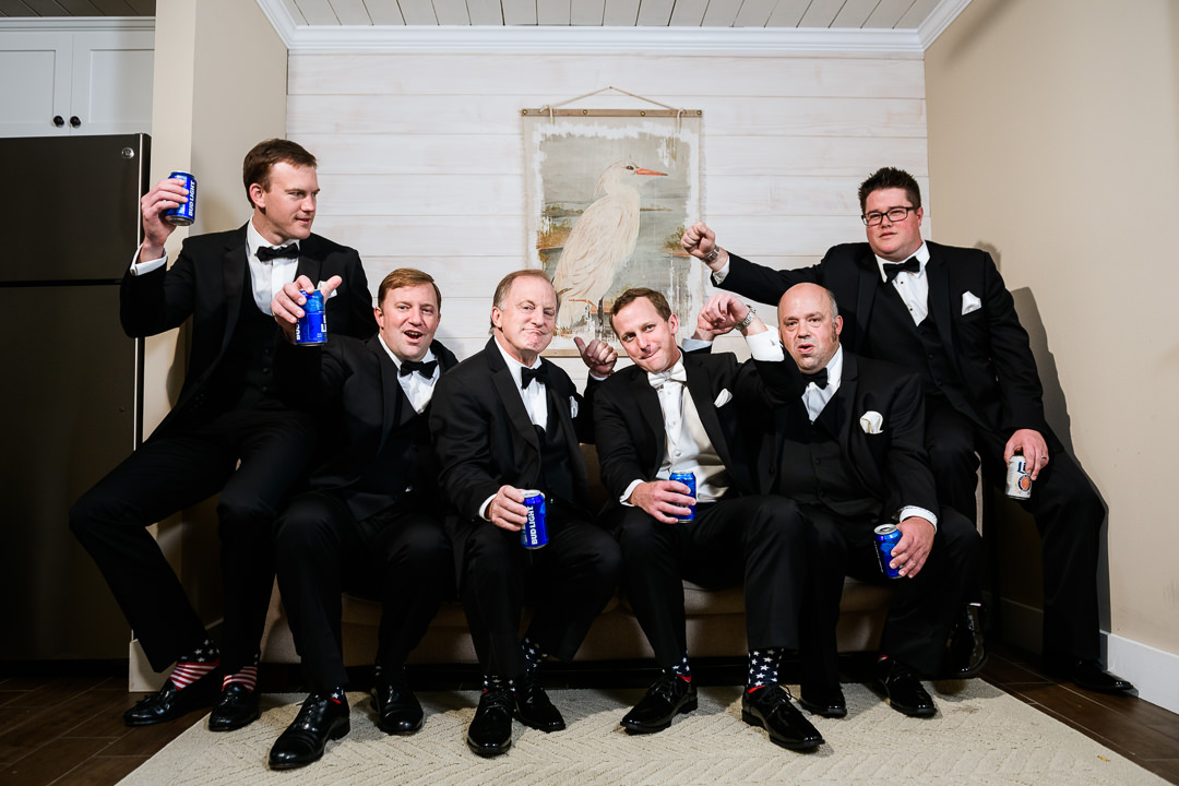 Groomsmen cheering at the Destin Bay House Wedding, black tie wedding, American flag groomsmen socks, Destin Florida, Lazzat Photography, Florida wedding photographer, Orlando wedding photographer