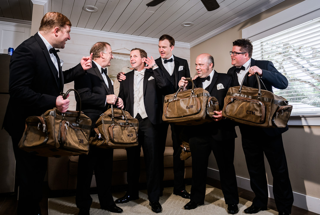 Groomsmen getting their gifts at the Destin Bay House Wedding, black tie wedding, unique groomsmen gifts, Destin Florida, Lazzat Photography, Florida wedding photographer, Orlando wedding photographer
