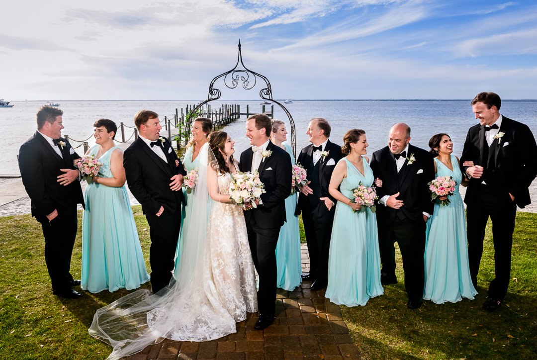 Bride and Groom laughing with their wedding party, black tie wedding, blue Bridesmaid dresses Destin Bay House Wedding, Destin Florida, Lazzat Photography, Florida wedding photographer, Orlando wedding photographer