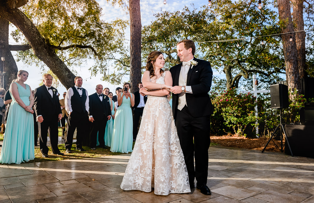Bride and Groom during their first dance, black tie wedding, blue Bridesmaid dresses Destin Bay House Wedding, Destin Florida, Lazzat Photography, Florida wedding photographer, Orlando wedding photographer