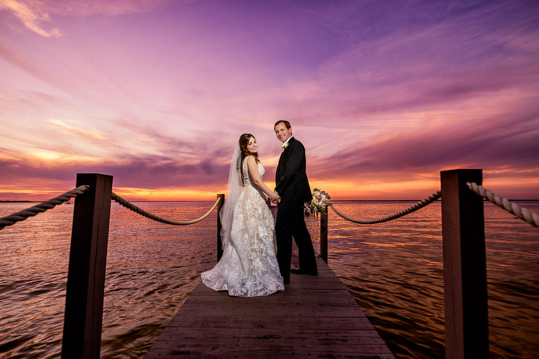 Bride and Groom looking back at sunset on the pier, Destin Bay House Wedding, Destin Florida, Lazzat Photography, Florida wedding photographer, Orlando wedding photographer