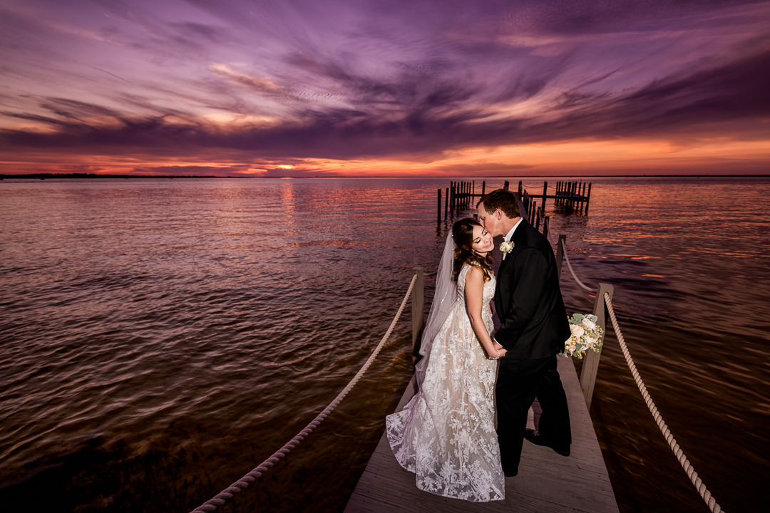 Groom kissing Bride at sunset on the pier, Destin Bay House Wedding, Destin Florida, Lazzat Photography, Florida wedding photographer, Orlando wedding photographer