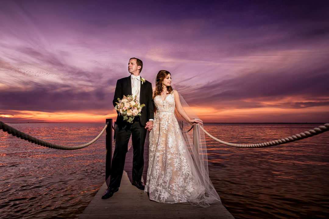 Bride and Groom looking away at sunset on the pier, Destin Bay House Wedding, Destin Florida, Lazzat Photography, Florida wedding photographer, Orlando wedding photographer
