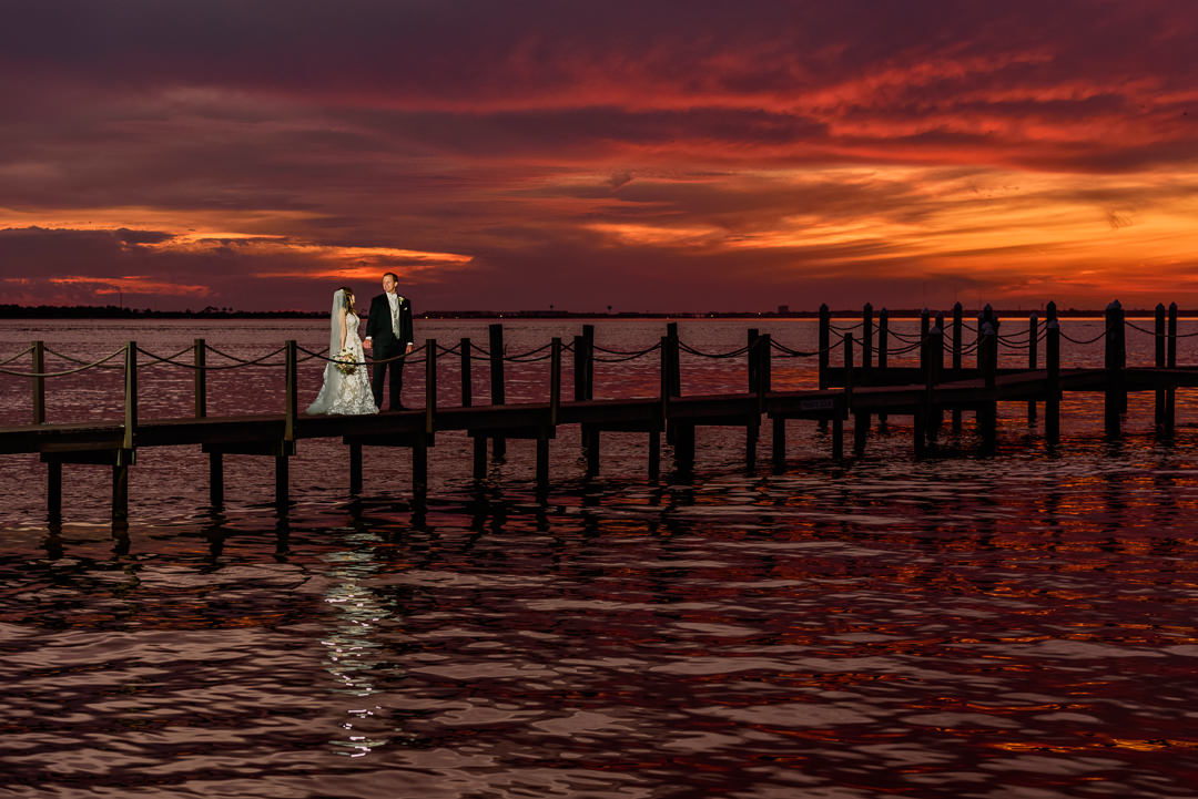 Bride and Groom holding hands at sunset on the pier, sunset wedding photos, Destin Bay House Wedding, Destin Florida, Lazzat Photography, Florida wedding photographer, Orlando wedding photographer
