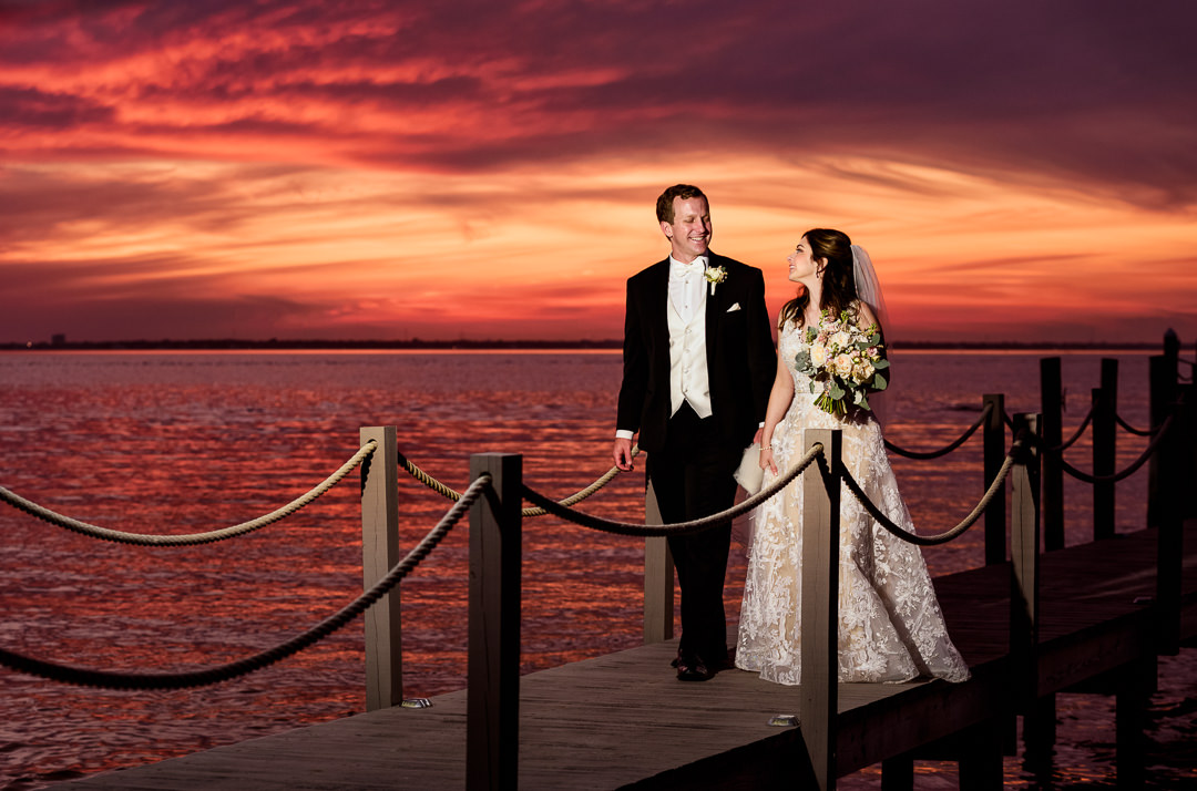 Bride and Groom walking on the pier at sunset, sunset wedding photos, Destin Bay House Wedding, Destin Florida, Lazzat Photography, Florida wedding photographer, Orlando wedding photographer
