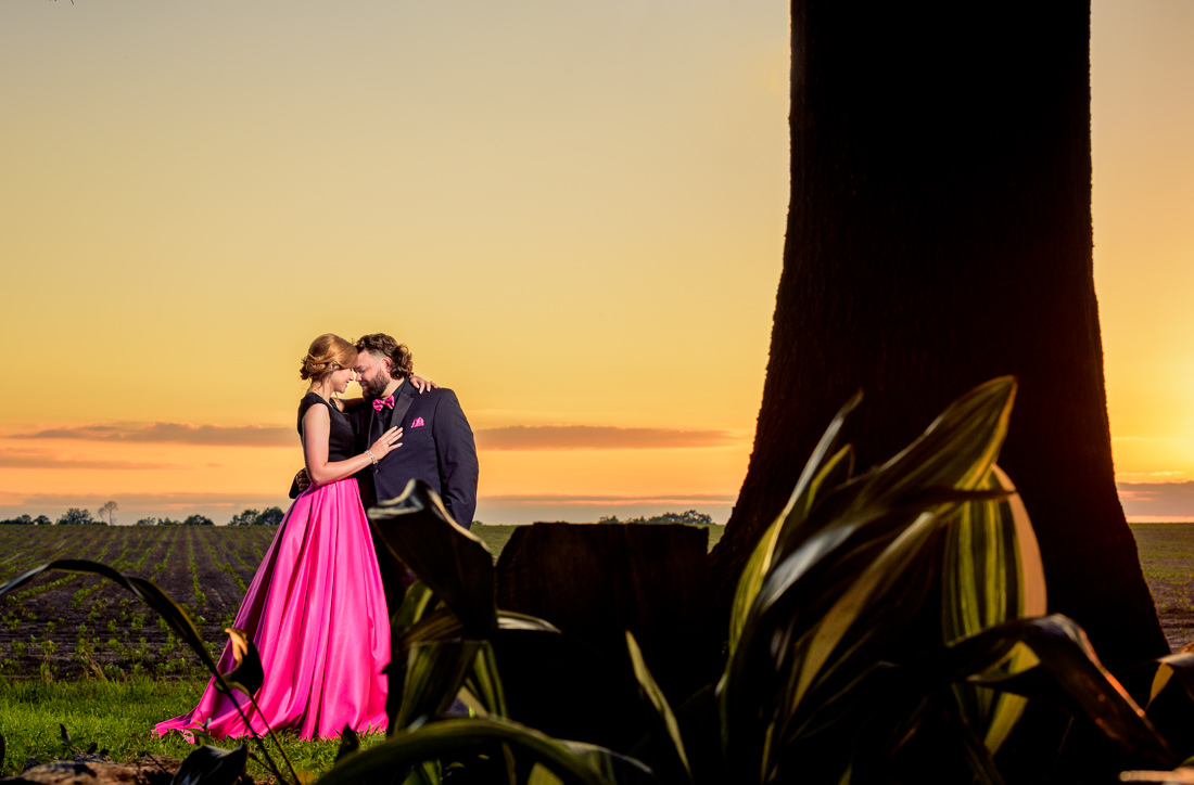 Couple head to head at sunset, hot pink and black outfits, 70's and 80's Themed Engagement Session, Coldwater Gardens, Florida engagement photographer, Orlando engagement photographer, Lazzat Photography